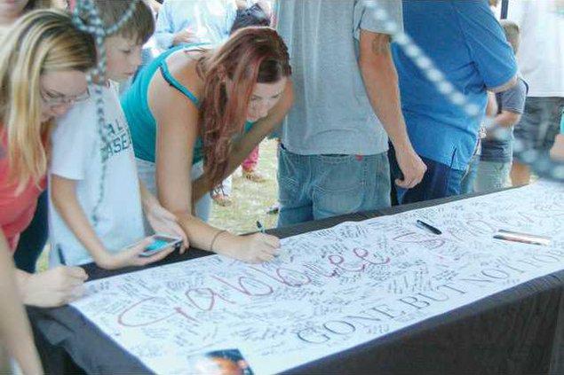 Vigil banner signingWEB